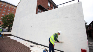 The money will be used to re-paint 'offensive' murals with other imagery.