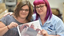 Andrea Hanvey (left) and Amy Duncan with a photo of Neil