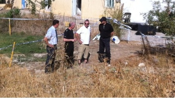 Ben's grandfather Eddie with police at the scene of the toddler's disappearance in Kos.