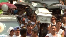 Rows of coffins show extent of Philippines' war on drugs