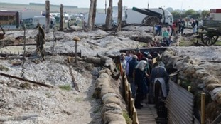 Visitors walking through the authentically created replica WW1 trench system in 2014