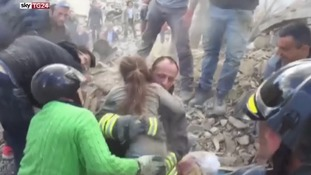 Girl pulled from rubble almost 24 hours after Italy earthquake