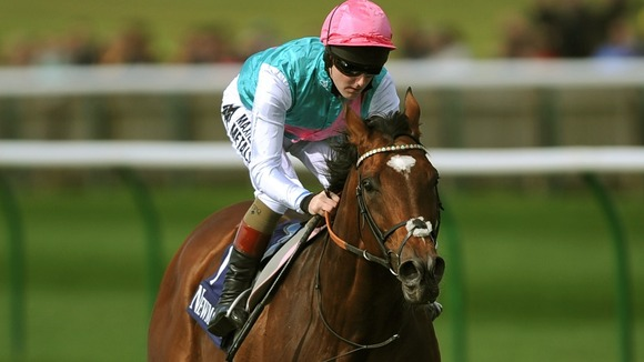 Frankel, ridden by Tom Queally on the Gallops at Newmarket Racecourse last month