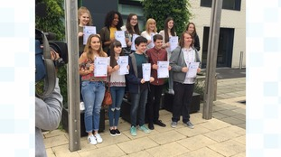 Students receive their GCSE reults at Wade Deacon High School on the Wirral