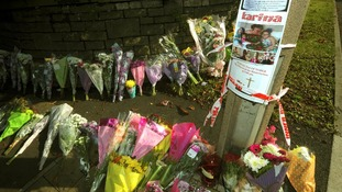 Floral tributes outside the Fire Station in Ely, Cardiff, where Karina Menzies, 32, was killed
