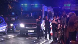 Police patrol the scene at Hyde Park