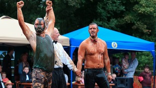Competitors take part in the World Gravy Wrestling Championships at the Rose n Bowl, Stackteads in Lancashire.
