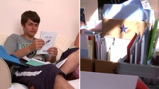 Ollie and Karen Jones opening some of the thousands of birthday cards he's received from all over the world.