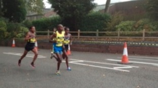 The first elite runners taking part in the Birmingham Half Marathon are passing Cadbury's in Bournville