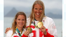 Saskia Clark (right) with her sailing partner and Hannah Mills after winning gold in Rio