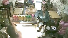 Thief caught on camera as she pinches tip jar from cafe