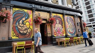 Notting Hill businesses board up windows for Carnival.