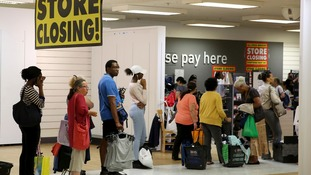 People queue in the closing down sale of a branch of BHS