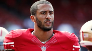 NFL player criticised for refusing to stand for US national anthem