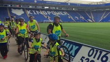 Riders cycling through the King Power Stadium