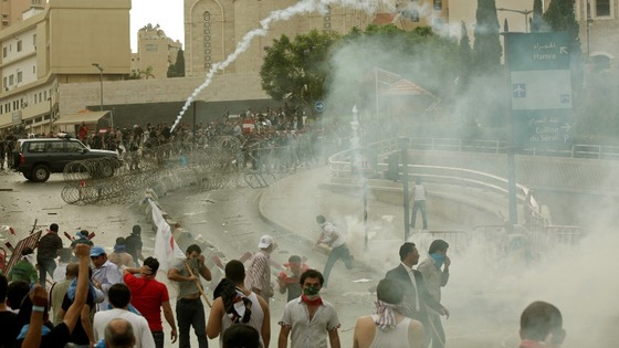 Lebanese policemen fire tear gas during clashes with angry protesters in Beirut