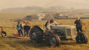 Where it all began: the Awty family during one of their first harvests