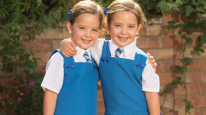 The four-year-old twins are looking forward to joining their big sister at school.