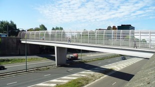 Work begins to replace footbridge canopy over M602