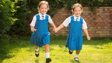 Separated twins defy odds to start first day at school