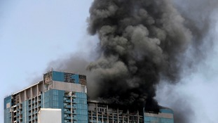 Firefighters battle blaze at high-rise building in Abu Dhabi