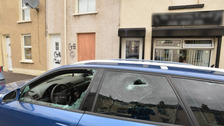 A car's windows were smashed and graffiti was sprayed in a suspected hate attack in Larne earlier this month.