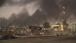 Charred remains of the town were left by IS