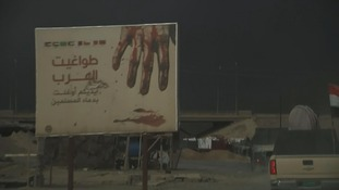 IS propaganda seen on a billboard