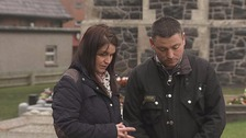 Michelle and Barry Rocks leave flowers at their daughter's grave.