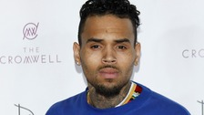 Singer Chris Brown arrested for 'pointing gun at beauty queen'