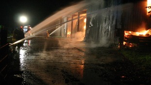 Water jets are used to put out the flames