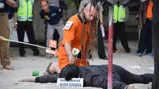 British man accused of killing Bali police officer re-enacts attack