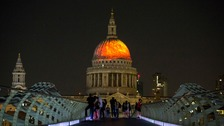 The dome of St Paul's Cathedral lit up with a fiery projection