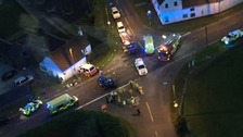 A camper van smashed in to a house and four people were injured following a crash in Staffordshire
