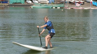 Paddle-boarding on Whitlingham Broad.