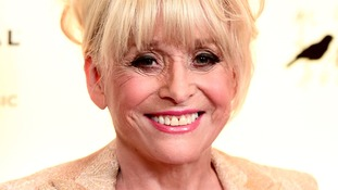 Dame Barbara Windsor will switch on the lights tonight