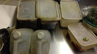 Filthy tubs containing food and greasy containers cut down and used as food scoops
