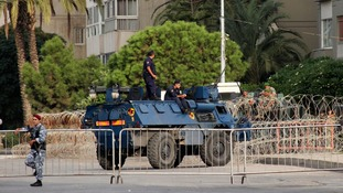 Lebanese Army soldiers and anti-riot police secure the area near the Prime Minister's residence in Tripoli.