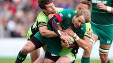 Leicester Tigers Mathew Tait is tackled by Northampton's Dom Waldouck and James Wilson