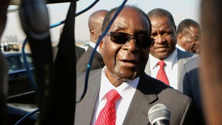 Robert Mugabe made light of media reports he had suffered a stroke as he arrived home.