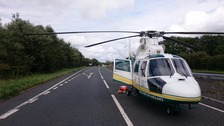 Air ambulance at the scene on the A590