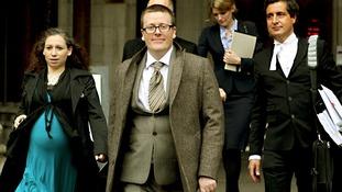Frankie Boyle leaves the High Court after winning more than £54,000 in damages