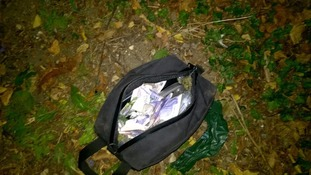 Officers found the bag, full of £10 and £20 notes, in Lower Sundon