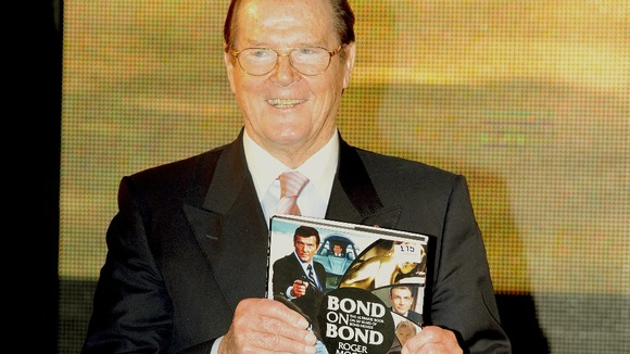 Sir Roger Moore poses with his new book 'Bond on Bond'