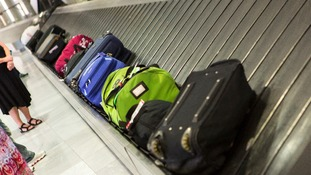 Boy injured after becoming 'trapped' on baggage belt