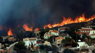 Spanish firefighters are still working to bring under control a forest blaze near Valencia that forced the evacuation of around 2,000 people