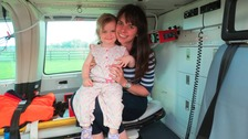 Scarlett with mother Rachel Hall inside the air ambulance.