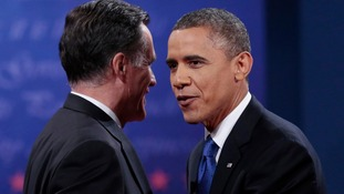 Republican presidential candidate Mitt Romney and US President Barack Obama at the conclusion of the debate