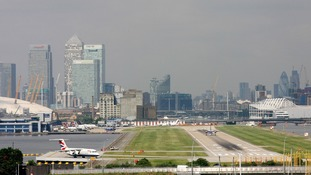 Protesters lock themselves to tripod at London City Airport runway