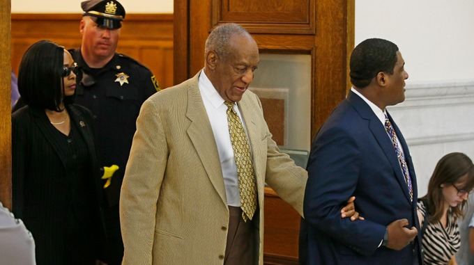 Cosby was helped into court by an aide.